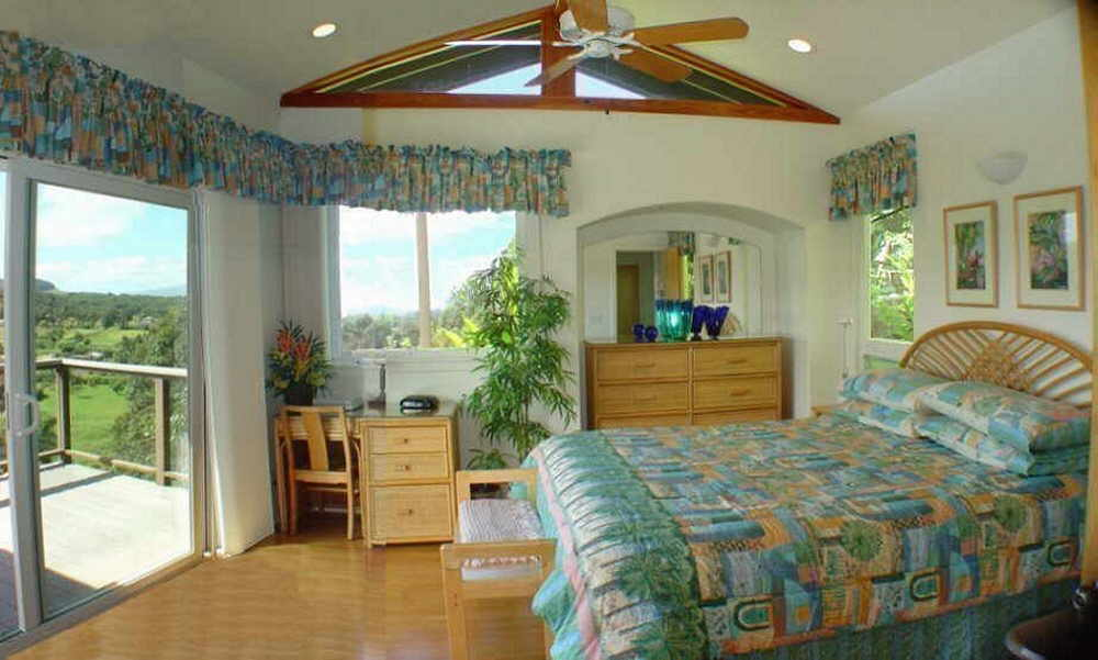 Plush king-size beds in a honeymoon cottage on Maui