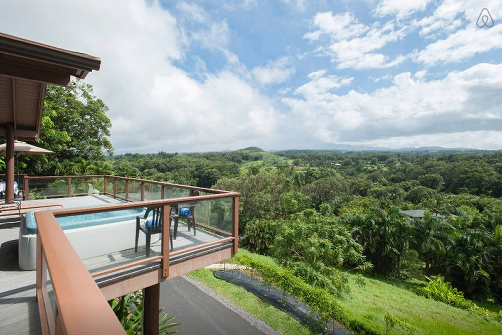 The deck offers a view of the volcano, rainforest and ocean