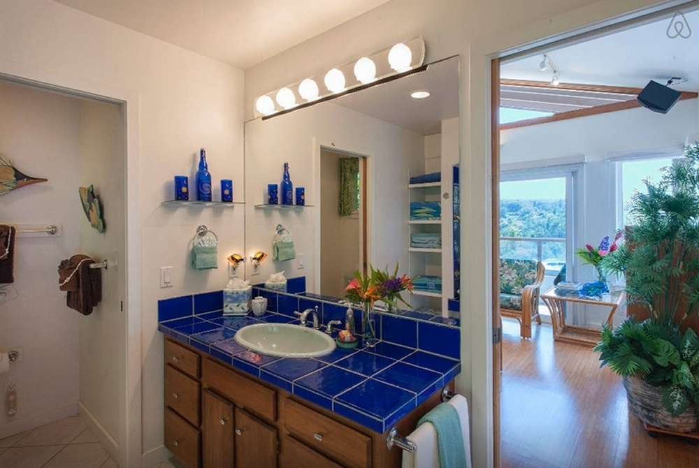 Bath is accented with cobalt-blue glass tile